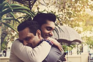 Same-sex couple hugging after surprise engagement by Cape Town Event Photographer