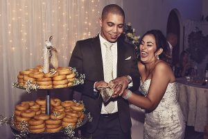 Wedding couple cutting the cake by Cape Town Event Photographer